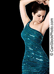Woman in ball gown - A beautiful woman dancing in a sparkley...