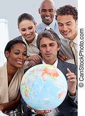 Diverse business group smiling at global business expansion...