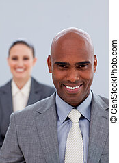 Focus on an attractive ethnic businessman smiling