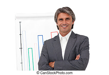 Smiling mature businessman in front of a board - Smiling...