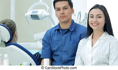 New working day dentists. The girl-intern beside the the...