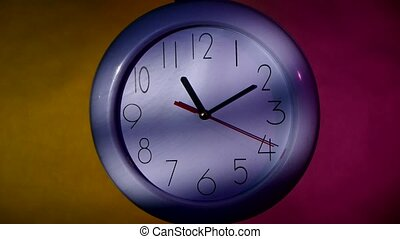 office white clock on colorful background - office close up...