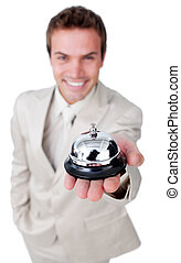 Attractive businessman showing a service bell