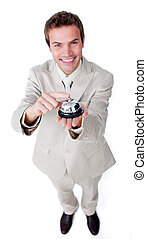 Smiling confident businessman using a service bell isolated...