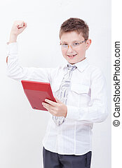 Portrait of teen boy with calculator on white background -...
