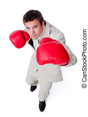 Charismatic businessman beating the competition isolated on...