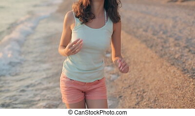 Charming woman smiling and posing on a beach - Charming...
