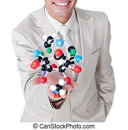close-up, homem negócios, segurando, molécula