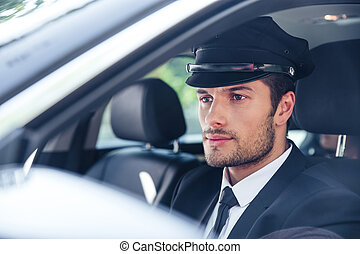 Male chauffeur sitting in a car - Portrait of a handsome...