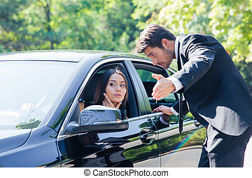 Man helping woman - Man points the direction at the road to...
