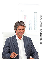 Smiling mature businessman in a meeting