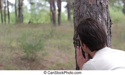 Man Looking and Spying a Nature Background - Man Looking a...