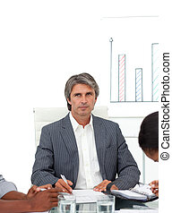 Charismatic mature businessman in a meeting