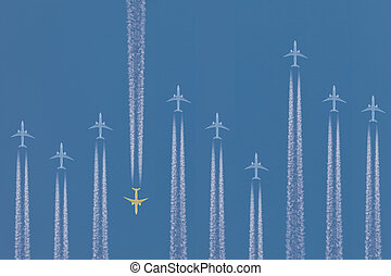 Row of airplanes flying by with one in the other direction -...