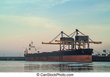 Cargo ship loading with coal in The Netherlands during...