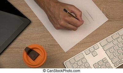 Graphic designer writing Idea
