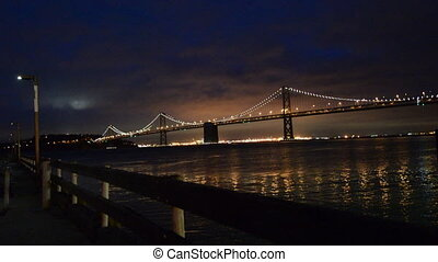 Oakland Bay Bridge lights in dusk in San Francisco,...