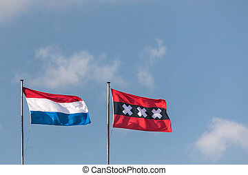 Dutch national flag and the Amsterdam city flag in a row -...