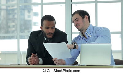 Business plan Two Confident businessman checking documents...