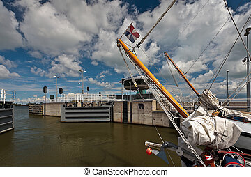 Traditional sailship leaving a sluice at the Markermeer in...