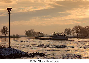 Riverboat during winter on the river IJssel in The...
