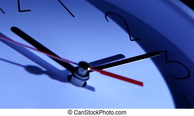 An image of a clock at twelve. Close up of a watch on black...