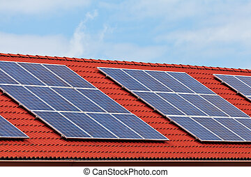 Solar panels on the roof of a row of newly build houses