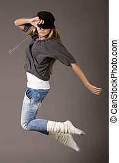 Young women jumping during her dance