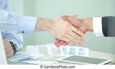 Business handshake Two successful businessman sitting at the...