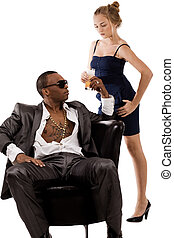 Young lady gives juice to the black man