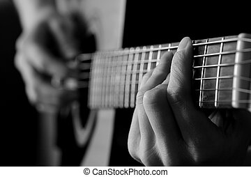 Closeup of Guitar Strings for Music - Closeup detail of...
