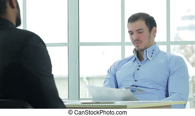 Preparing a business plan Two successful businessman sitting...
