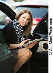 Woman Working From Car