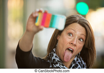 Sticking Out Tongue Selfie - Woman sticking out her tongue...