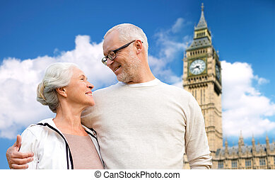 happy senior couple over big ben tower in london - family,...