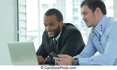 Busy businessman Two confident businessman sitting at the...