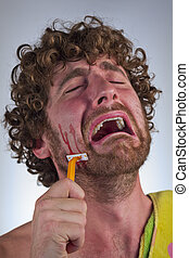 Blood Cut Shaving - Silly bearded man cuts his face while...