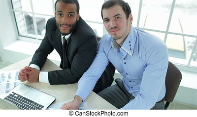 Successful business team Two successful businessman smiling...