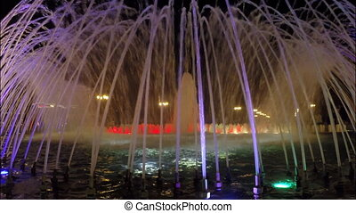 Fountain with multicolored lights at night