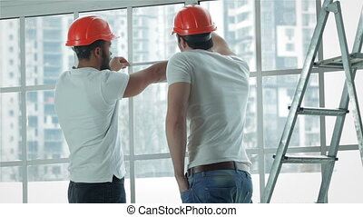 Two workers make measurements of windows and repairs - New...