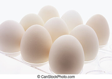 White Eggs on Plastic Egg Carton - Close Up of White Eggs on...
