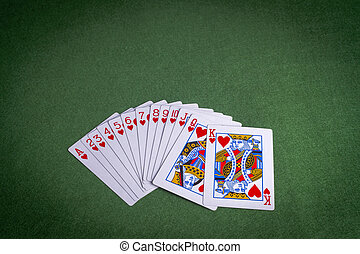 Full suit of Hearts cards on green felt background