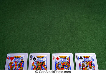 Full set of King Playing cards on green felt background