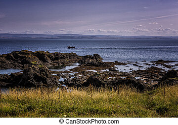 Dramatic rocky coastline in Elie Scotland