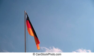 Germany flag in front of a blue sky in the wind
