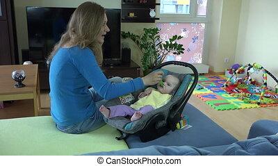 baby eat porridge mother - zoom in of little baby eat...