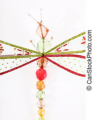 Colors - Butterfly made with different colored pieces over...