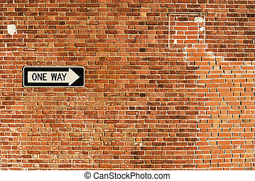 One way road signal on the wall in an american city