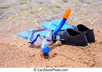 Skin diving equipment standing ready on a beach