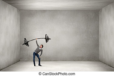Strong and powerful - Confident man lifting above head...